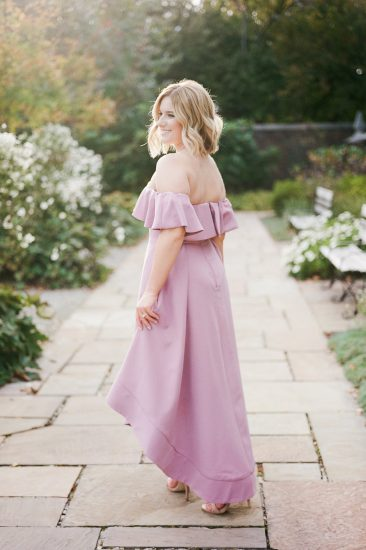 woman posing in a mauve off the shoulder dress