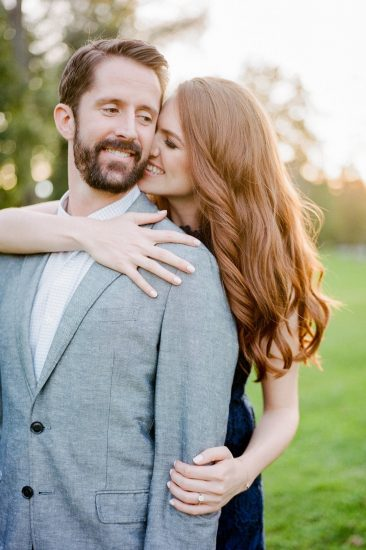 woman snuggling up to her man during engagement photos