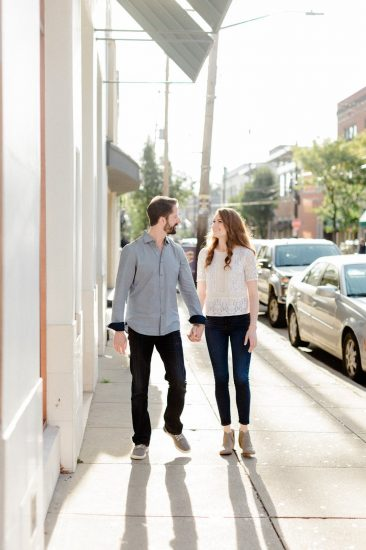 Couple holding hands while walking through Shadyside