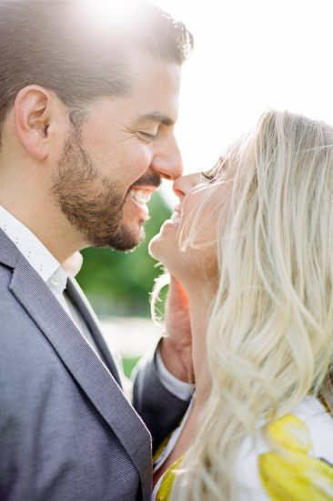 Couple eskimo kissing during engagement photos