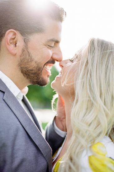 Couple eskimo kissing during engagement photos