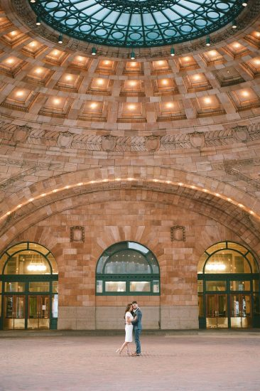 Couple embracing in the rotunda at the Pennsylvanian