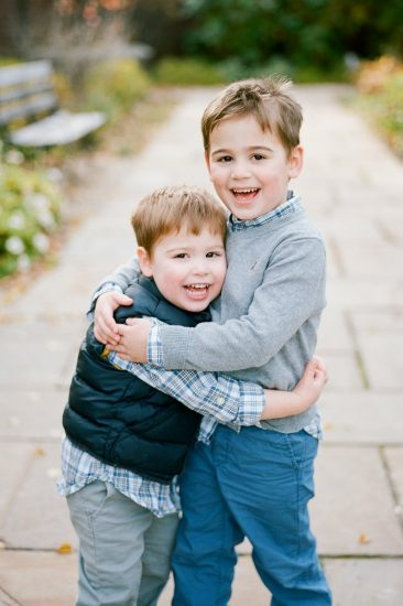 Children and brothers hugging each other