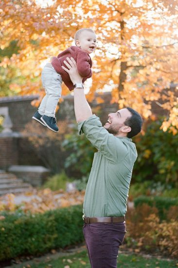 Dad throwing his son up in the air and catching him