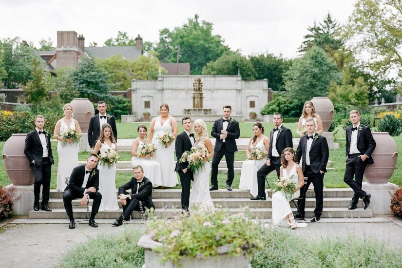 bridal party posing in vogue vanity fair styled photo of the steps of mellon park