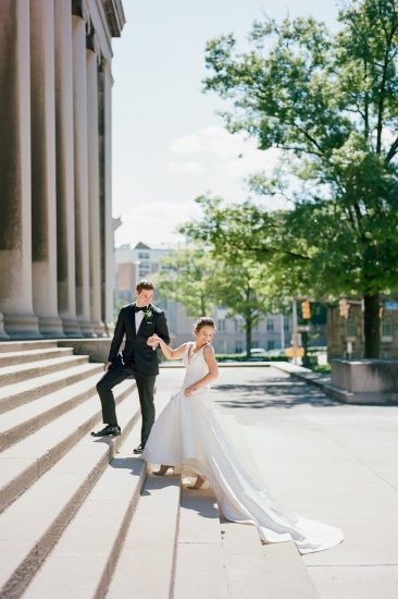 Bride and groom walking up the steps to the Mellon Institute Columns