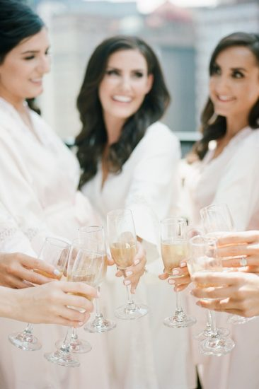 champagne toast with bridesmaids on rooftop of Renaissance hotel
