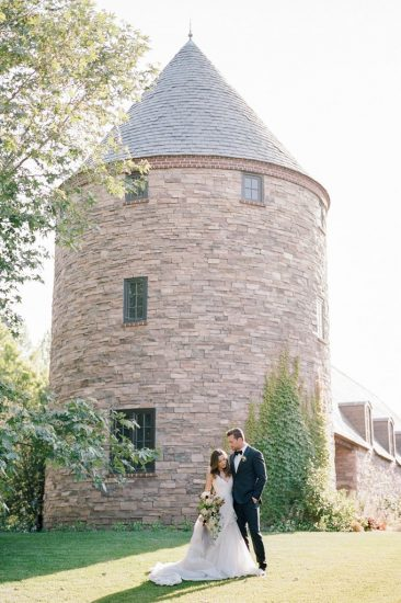 bride and groom standing tother near a silo at kestrel park
