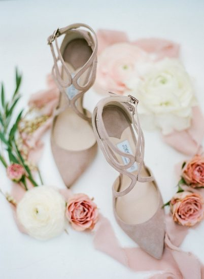 Jimmy choo mause suede pumps surrounded by flowers