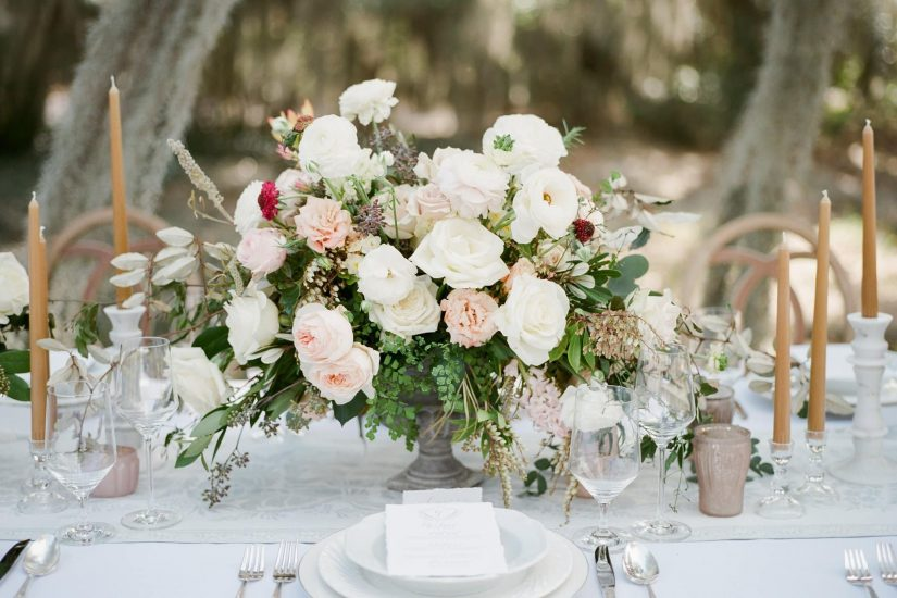 table set up with pink and white flower centerpieces