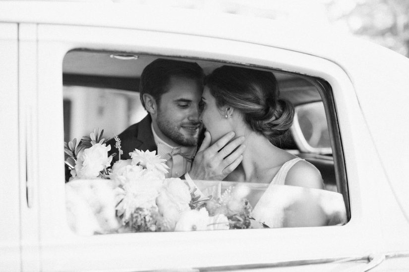 couple kissing in a rolls royce vintage car