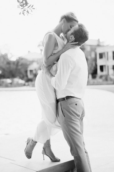 Couple passionately kissing in Charleston