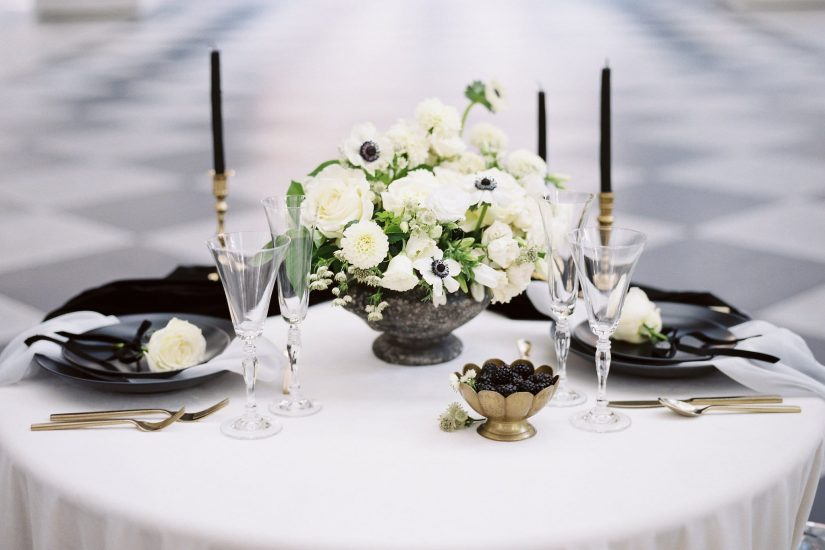 table design with black and white accents and black candles
